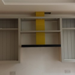 Cupboards assembled around extractor